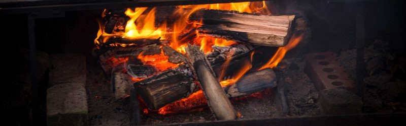 nature tours tasmania - burning fire with orange flames from logs